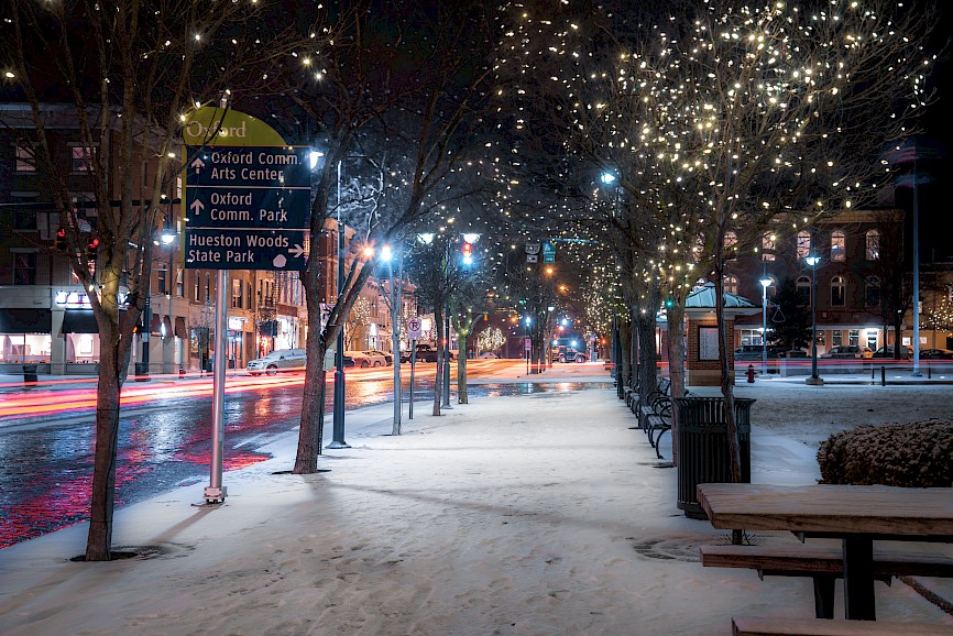 Uptown Oxford at night with sparkling lights in the trees and snow on the ground