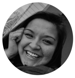 A black and white photo of the blog's author, LeeAnn, smiling while resting her face on her hand