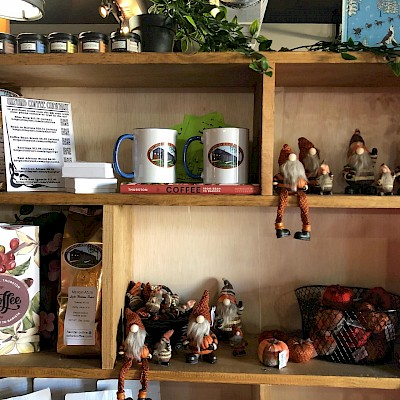 Bookshelves covered in mugs and little autumn gnomes for sale