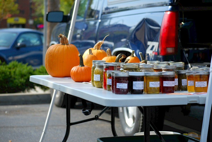 Pumpkins and canned preserves on a table at the Farmers Market