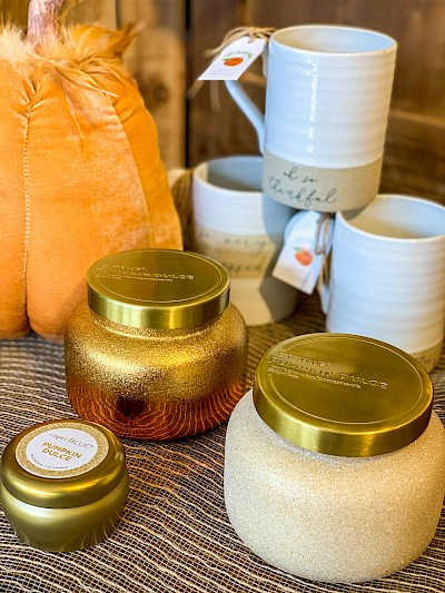 Shiny, sparkly candles and mugs with pumpkin tags